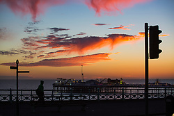 © Licensed to London News Pictures. 28/12/2016. Brighton, UK. A colourful sunset hangs above Brighton Palace Pier as the mild and dry weather continues in the South of the UK. Photo credit: Hugo Michiels/LNP