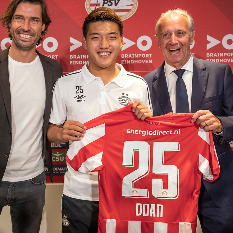 Japan's soccer player Ritsu Doan signs his new contract / holds the team shirt after signing the new contract / answers questions during an interview after signing the new contract / with PSV at the Philips stadium in Eindhoven, Netherlands, Saturday August 31, 2019. PSV finalized the deal with the 21-year-old Japanese international who transfers from FC Groningen to PSV. (AP Photo/Patrick Post)