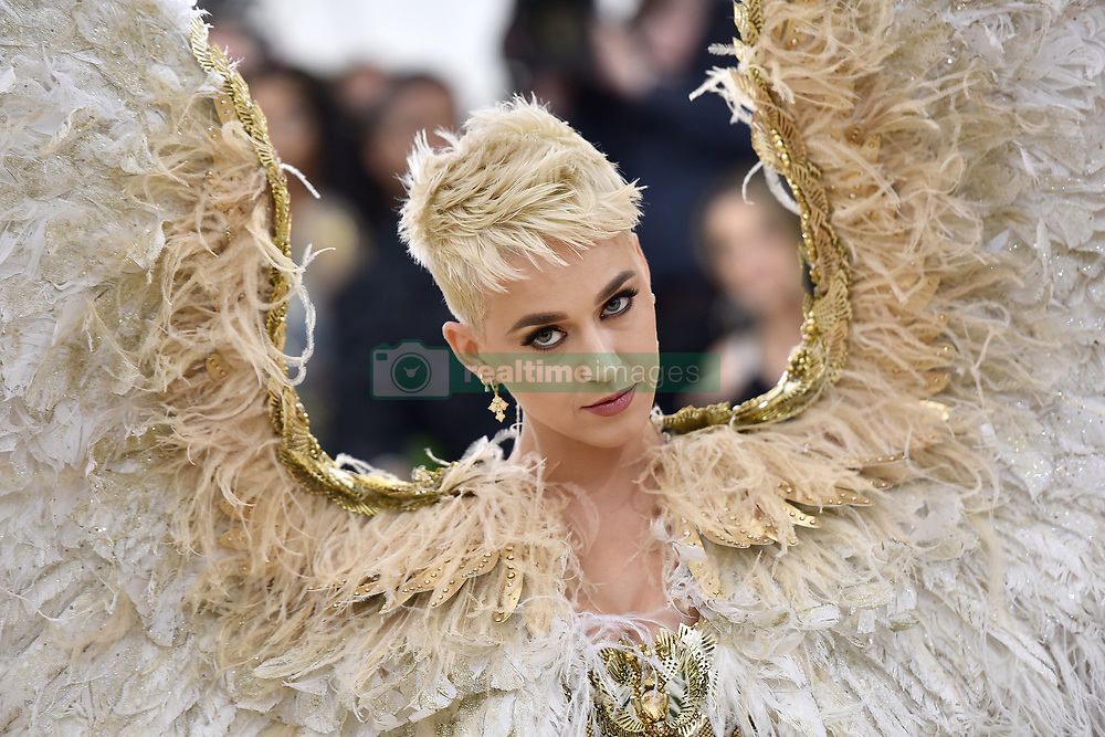 Katy Perry walking the red carpet at The Metropolitan Museum of Art Costume Institute Benefit celebrating the opening of Heavenly Bodies : Fashion and the Catholic Imagination held at The Metropolitan Museum of Art  in New York, NY, on May 7, 2018. (Photo by Anthony Behar/Sipa USA)
