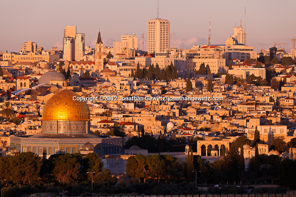 Morning sun illuminates old and new Jerusalem in this view from the Mount of Olives. WATERMARKS WILL NOT APPEAR ON PRINTS OR LICENSED IMAGES.