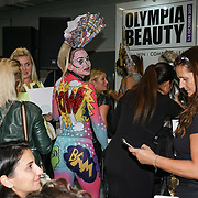 Olympia London, London, England, UK. Model Zara Cobeiss by Follies Face and Body Art, showcases her latest works and the winner of Comic Strip Couture Body Painting Competition, at The Olympia Beauty show at Kensington Olympia in London on 1st October 2017.