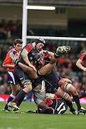 tough tackling as Ryan Jones and Dan Lydiate of Wales stop Fiji's Seremaia Bai. Invesco Perpetual series, Wales v Fiji , rugby international match at the Millennium Stadium in Cardiff on Friday 19th Nov 2010.  pic by Andrew Orchard, Andrew Orchard sports photography,