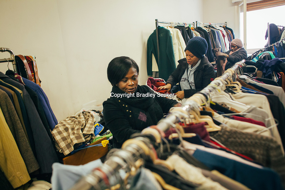 Women look for clothing at the Kartitas centre in downtown Athens. The centre provides free clothing to anyone who is in need, twice a week.