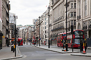 Piccadillly is eerily quiet and silent on empty streets with virtually no cars as lockdown continues and people observe the stay at home message in the capital on 12th May 2020 in London, England, United Kingdom. Coronavirus or Covid-19 is a new respiratory illness that has not previously been seen in humans. While much or Europe has been placed into lockdown, the UK government has now announced a slight relaxation of the stringent rules as part of their long term strategy, and in particular social distancing.