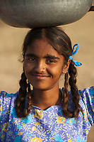 """A girl collecting camel dung used as fuel for cooking fires. Pushkar Camel Fair, India<br /> Available as Fine Art Print in the following sizes:<br /> 08""""x12""""US$   100.00<br /> 10""""x15""""US$ 150.00<br /> 12""""x18""""US$ 200.00<br /> 16""""x24""""US$ 300.00<br /> 20""""x30""""US$ 500.00"""