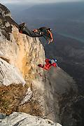 Wingsuit BASE-jumpers Robi Pecnik and Vanja Silvak, Monte Brento, Italy