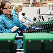 Sandy Nguyen inspects circuit boards at ControlTek, a circuit board manufacturer in Vancouver, Wash., that has been affected by tariffs.<br /> <br /> For the first year of President Trump's trade war with China, many American manufacturers found ways to get by -- making contingency plans, but avoiding long-term changes in anticipation of a deal. But now with a deal seemingly a long way off, and tensions likely to continue regardless, companies are revisiting that approach. Electronics manufacturers are caught up not just in the tariffs but also in the national security fight over Huawei and other firms.