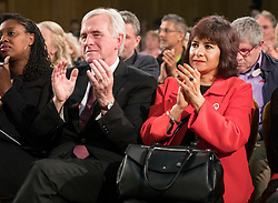 © Licensed to London News Pictures. 20/04/2017. London, UK. Labour Party shadow chancellor John McDonnell (L) and Laura Alvarez , wife of party leader Jeremy Corbyn applaud as he delivers his first election campaign speech in Church House in Westminster, London.. Campaigning has begun for a snap election which was called by British Prime Minister Theresa May, earlier this week. Photo credit: Peter Macdiarmid/LNP