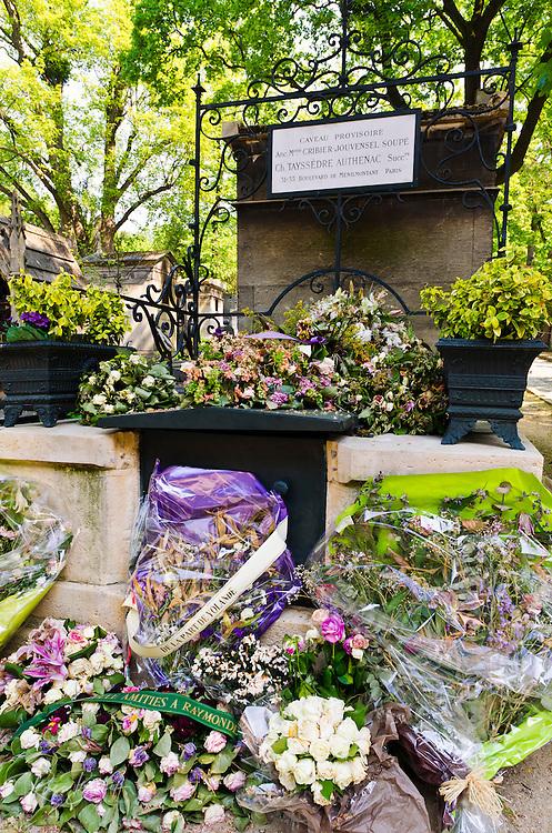Flowers on graves at Père Lachaise Cemetery, Paris, France