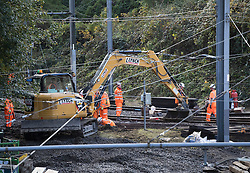 © Licensed to London News Pictures. 13/11/2016. Croydon, UK. Engineers work to restore the line at the site where seven people dies and 50 were injured when a tram rolled over on Wednesday 9th November. Photo credit: Peter Macdiarmid/LNP