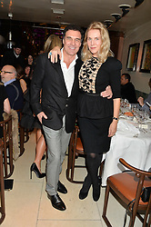 ANDRE BALAZS and GAEL BOGLIONE at a dinner to celebrate the publication of Obsessive Creative by Collette Dinnigan hosted by Charlotte Stockdale and Marc Newson held at Mr Chow, Knightsbridge, London on 9th February 2015.