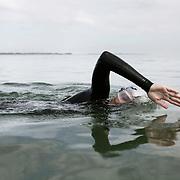 Wild swimming. Louise Melgaard Bruun swimming in the waters near Århus, Denmark.