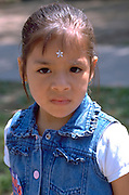 Girl age 4 with star on forehead. In the Heart of the Beast May Day Festival and Parade Minneapolis  Minnesota USA