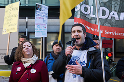 London, UK. 22nd January, 2019. Petros Elia, General Secretary of United Voices of the World (UVW) addresses support staff at the Department for Business, Energy and Industrial Strategy (BEIS) represented by the Public and Commercial Services (PCS) union on the picket line after beginning a strike for the London Living Wage of £10.55 per hour and parity of sick pay and annual leave allowance with civil servants. The strike is being coordinated with receptionists, security staff and cleaners at the Ministry of Justice (MoJ) represented by the UVW.
