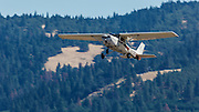 1971 Cessna 150L taking off with student pilot at Hood River.