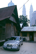 Home in Kuala Lumpur near the Petronas Towers with Mercedes.