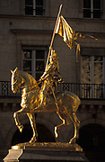 The golden statue of Joan of Arc carrying her banner, sparkles in sunshine, on 3rd September 2007, in Paris, France. Jeanne dArc is an 1874 French gilded bronze equestrian sculpture of Joan of Arc by Emmanuel Frémiet. The outdoor statue is prominently displayed in the Place des Pyramides in Paris.