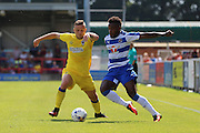 AFC Wimbledon midfielder Dean Parrett (18) and Reading FC midfielder Tarique Fosu battle during the Pre-Season Friendly match between AFC Wimbledon and Reading at the Cherry Red Records Stadium, Kingston, England on 23 July 2016. Photo by Stuart Butcher.
