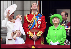 Image ©Licensed to i-Images Picture Agency. 11/06/2016. London, United Kingdom. Trooping the Colour. Prince George and Princess Charlotte with their parents the Duke and Duchess of Cambridge join  HM Queen Elizabeth II and the Duke Edinburgh and other members of the Royal family on the Balcony of Buckingham Palace for Trooping the colour. Trooping the Colour. The Sovereign's birthday is officially celebrated by the ceremony of Trooping the Colour. This impressive display of pageantry by her personal troops, the Household Division, on Horse Guards Parade, with Her Majesty the Queen herself attending and taking the salute. Over 1400 officers and men are on parade, together with two hundred horses; over four hundred musicians from ten bands and corps of drums march and play as onePicture by Andrew Parsons / i-Images