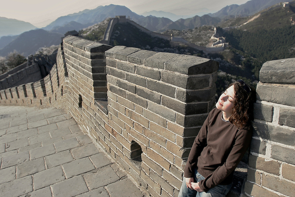 A visitor enjoys a break after climbing The Great Wall at the Badaling section in China.