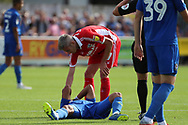 AFC Wimbledon striker Andy Barcham (17) down with injury during the EFL Sky Bet League 1 match between AFC Wimbledon and Scunthorpe United at the Cherry Red Records Stadium, Kingston, England on 15 September 2018.