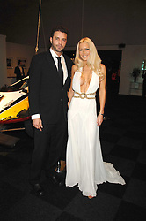EMMA NOBLE and TONY SCHIENA at a preview of a forthcoming sale of cars from the Bernie Ecclestone Car Collection held at Battersea Evolution, Battersea Park, London SW11 on 30th October 2007.<br /><br />NON EXCLUSIVE - WORLD RIGHTS