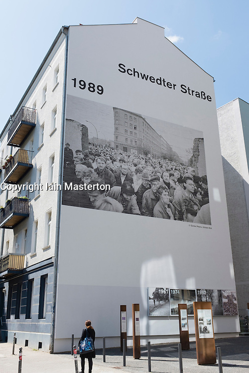 Mural on gable end of apartment building marking  former route of Berlin Wall at Schwedter Strasse in Prenzlauer Berg in Berlin Germany