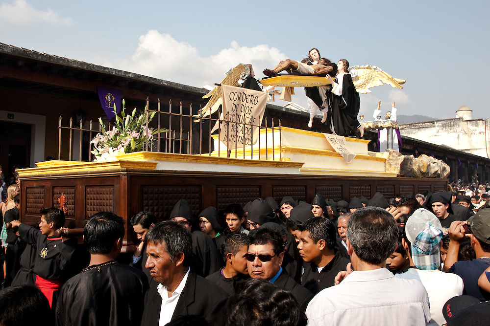 Street Photography of the people  and processions for Semana Santa, the Catholic Holy week in Antigua, Guatemala, Central America 2010. The religious processions then walk over the beautiful,intricately designed flower carpets carrying effigies  of Jesus and Mary.