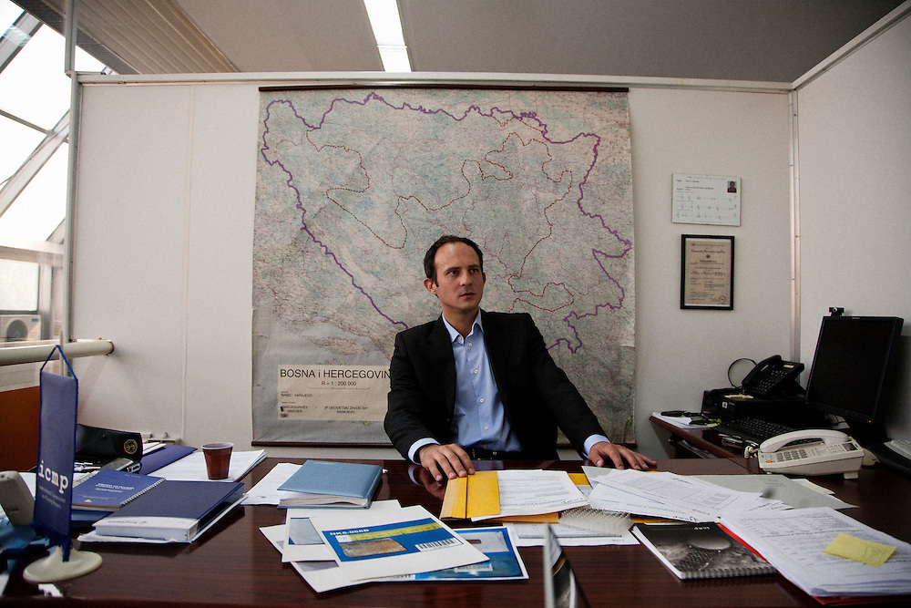 Edin Jasaragic, Head of Identification Coordination Division for the International Commision on Missing Persons, in his Tuzla office with a map of Bosnia and Herzegovina...Matt Lutton for The International Herald Tribune..Capture of Ratko Mladic. Tuzla, Bosnia and Herzegovina. May 30, 2011.