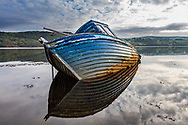 An old boat in the estuary near the village of Carrick in County Donegal, Ireland