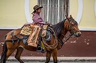 A young boy in full garb, in the Los Chagras parade in Cotacachi, Ecuador
