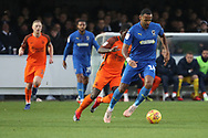 AFC Wimbledon midfielder Liam Trotter (14) dribbling during the EFL Sky Bet League 1 match between AFC Wimbledon and Southend United at the Cherry Red Records Stadium, Kingston, England on 24 November 2018.