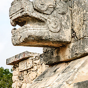 Jaguar head carved in stone at Chichen Itza Mayan civilizations ruins in Mexico.