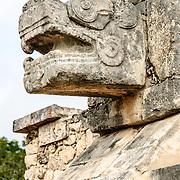 Jaguar head carved in stone at Chichen Itza Mayan civilizations ruins in Mexico.