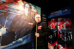 John Higgins enters the crucible during day seventeen of the 2018 Betfred World Championship at The Crucible, Sheffield.