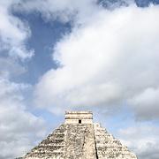 The pyramid of the Temple of Kukulkan (El Castillo) at Chichen Itza Archeological Zone, ruins of a major Maya civilization city in the heart of Mexico's Yucatan Peninsula.