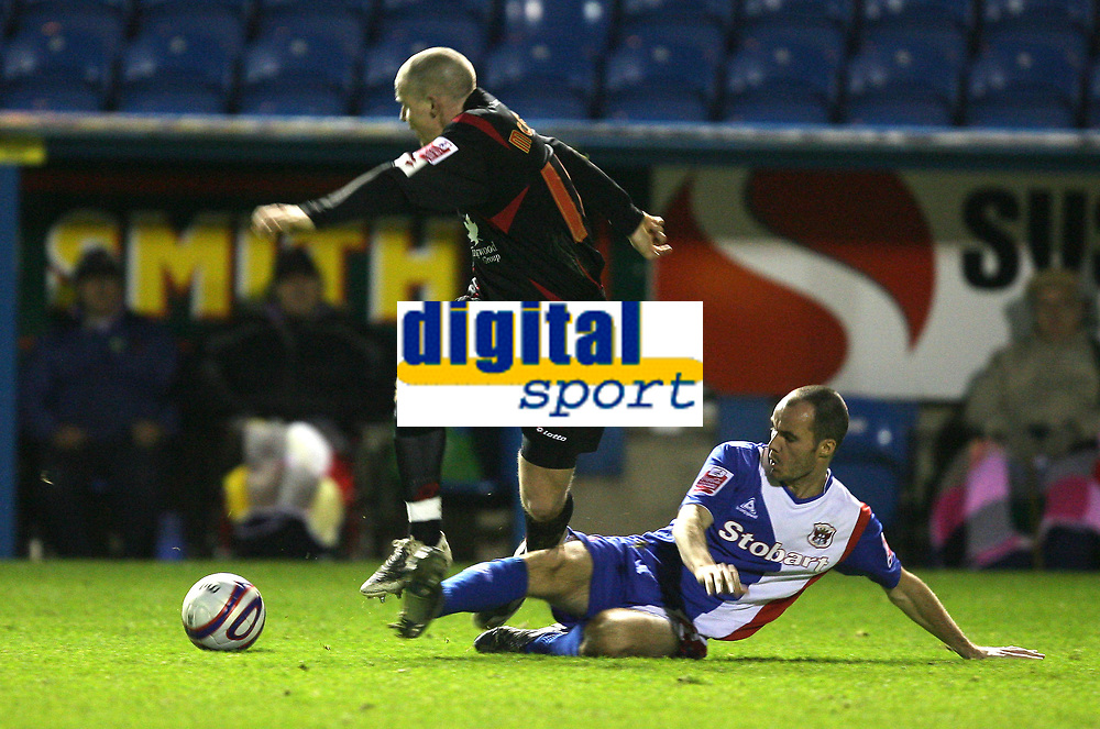 Photo: Paul Greenwood/Sportsbeat Images.<br />Carlisle United v Swindon Town. Coca Cola League 1. 04/12/2007.<br />Carlisle's Jon Paul McGovern, (L) looses the ball to Danny Carlton