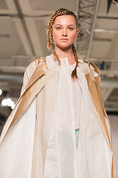 © Licensed to London News Pictures. 31/05/2014. London, England. Collection by Ellen Wilson from the University of Salford. Graduate Fashion Week 2014, Runway Show at the Old Truman Brewery in London, United Kingdom. Photo credit: Bettina Strenske/LNP
