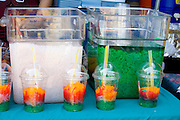 Hmong festival concession stand serving multicolored fruit drinks. Hmong Sports Festival McMurray Field St Paul Minnesota USA
