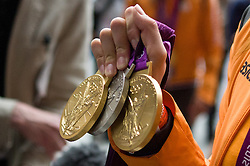 © Licensed to London News Pictures. 13/08/2012. London,UK. Dutch Women's Field Olympic Team pose with their gold medals at St. Pancras International as they leave the UK to head home following the 2012 Olympic games. Photo credit : Thomas Campean/LNP