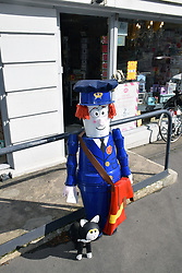 Postman Pat flowerpot man outside Settle post office, Yorkshire Dales UK Sep 2020. Every summer the town is decorated with quirky flowerpot creations
