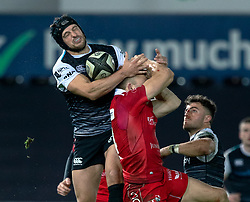 Dan Evans of Ospreys vies for the high ball with Tom Prydie of Scarlets<br /> <br /> Photographer Simon King/Replay Images<br /> <br /> Guinness PRO14 Round 11 - Ospreys v Scarlets - Saturday 22nd December 2018 - Liberty Stadium - Swansea<br /> <br /> World Copyright © Replay Images . All rights reserved. info@replayimages.co.uk - http://replayimages.co.uk