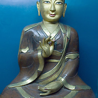 Buddha figure in Choijinlam Temple, a rare, remaining Tibetan Buddhist sanctuary in Ulaanbaator, Mongolia, a country where monks and lamas were executed after communist takeover.  The religion is making a resurgence after independence