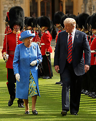US President Donald Trump and Queen Elizabeth II inspect a Guard of Honour, formed of the Coldstream Guards, at Windsor Castle, Windsor.