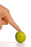 A finger over a lemon.