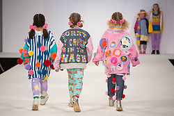 © Licensed to London News Pictures. 30/05/2015. London, UK. Children walk the runway during the Arts University Bournemouth fashion show at Graduate Fashion Week 2015 wearing the collection of graduate students Jess Russell and Georgia Walter. Graduate Fashion Week takes place from 30 May to 2 June 2015 at the Old Truman Brewery, Brick Lane. Photo credit : Bettina Strenske/LNP