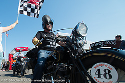 Bartek Mizerski riding his 1936 Sokol 1000 Polish motorcycle over the finish line at the end of Stage 16 (142 miles) of the Motorcycle Cannonball Cross-Country Endurance Run, which on this day ran from Yakima to Tacoma, WA, USA. Sunday, September 21, 2014.  Photography ©2014 Michael Lichter.
