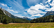 Standing wave clouds form patterns over Hedin Peak 2135m above the Dart Valley and Rees-Dart Track. In 5 days, we tramped the strenuous Rees-Dart Track for 39 miles plus 12.5 miles side trip to spectacular Cascade Saddle, in Mount Aspiring National Park, Otago region, South Island of New Zealand. This image was stitched from multiple overlapping photos.