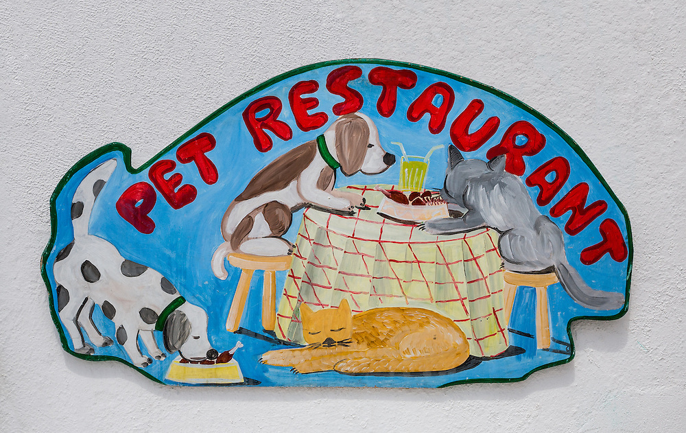 Restaurant Sign on Island of Mykonos in Greece catering to pets.  Licensing and Open Edition Prints.