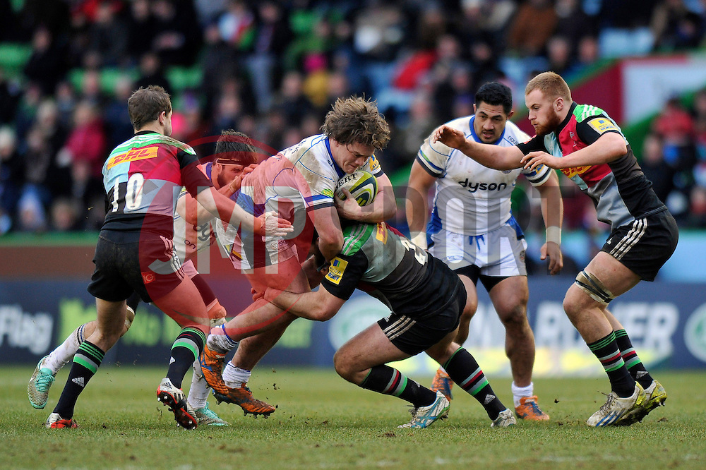 Nick Auterac of Bath Rugby takes on the Harlequins defence - Photo mandatory by-line: Patrick Khachfe/JMP - Mobile: 07966 386802 31/01/2015 - SPORT - RUGBY UNION - London - The Twickenham Stoop - Harlequins v Bath Rugby - LV= Cup